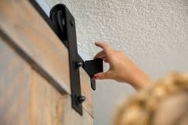 Drill In Cabinet Door Bumper Pads by How To Hang A Barn Door Home Improvement Projects To Inspire And