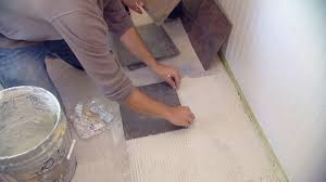 how to lay tile over an existing vinyl floor today s homeowner