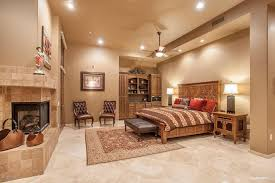 Contemporary Master Bedroom With Stone Fireplace Tuscany Classic 4x4 Tumbled Tile Hayes Tufted Leather