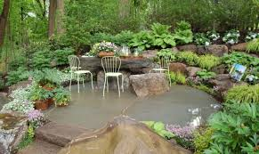Dainty Patio With Rock Garden Ideas Also Small Plants And Rustic Furniture Decoration