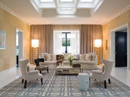 neutral transitional family room with curved sofa and living room