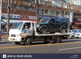 Car On Flatbed Tow Truck - Seoul, South Korea Stock Photo, Royalty ... Large Tow Trucks How Its Made Youtube Suburban1jpg Wreckers Pinterest Truck Rigs And Towing Auto Repair Maintenance Squires Services Car Carriers Virgofleet Nationwide 193 Best Abschleppwagen Images On Classic Truckfax Metro Goes Big Pink Eagle Usa Truck Business Advertising Vehicles Uber For Trucking Dispatch Software Texas Best Tow Truck Ford 9000 Vulcan 940 Trucks Dude Wheres My Car The Rules Regulations Of Tow Trucking To Stay Safe While Waiting A Tranbc