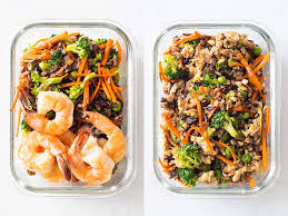 Two Containers Of Healthy Meal Prep Ideas Left With Shrimp Rice Blend And Veggies