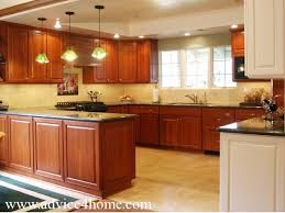 modern kitchen cabinets design and black marble top on platform in