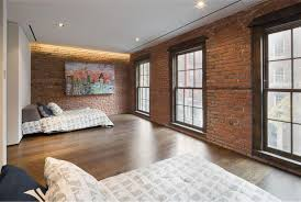 Interior Brown Brick Wall Theme And Glass Windows Connected By Wooden Laminate Floor