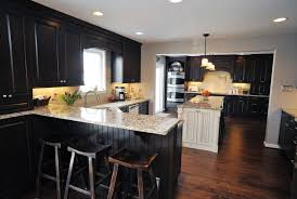 black kitchen cabinets with dark wood floors 3373 home and