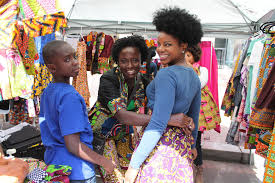 A Woman Sells West African Clothing At Market In Washington DC