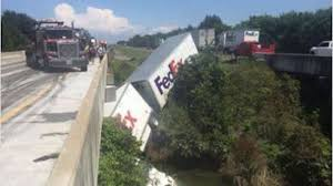 FedEx Tractor-trailer Plunges Off Highway Bridge In Arkansas | WTVR.com