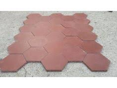 i the shape of these antique quarry tiles and they are in