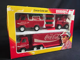 TWO VINTAGE BUDDY L COCA-COLA TOY TRUCKS, INC. MACK COCA-COLA ... 1960s Cacola Metal Toy Truck By Buddy L Side Opens Up 30 I Folk Art Smith Miller Coke Truck Smitty Toy Amazoncom Coke Cacola Semi Truck Vehicle 132 Scale Toy 2 Vintage Trucks 1 64 Ertl Diecast Coca Cola Amoco Tanker With Lot Of Bryoperated Toys Tomica Limited Lv92a Nissan Diesel 35 443012 Led Christmas Light Red Amazoncouk Delivery Collection Xdersbrian Lgb 25194 G Gauge Mogul Steamsoundsmoke Tender Trainz Pickup Transparent Png Stickpng Red Pressed Steel Buddy Trailer