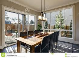 Sun Filled Dining Room In New Luxury Home Stock Photo ...