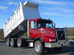 100 Tri Axle Dump Trucks 2007 VOLVO VHD TRIAXLE ALUMINUM DUMP TRUCK FOR SALE 438346