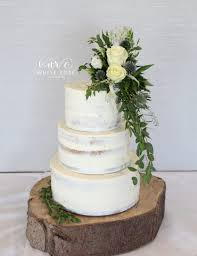Rustic Semi Naked Wedding Cake With Fresh Flowers At The Fleece Inn On Log