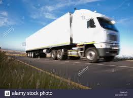 Semi-truck Driving On Remote Road Stock Photo: 36200121 - Alamy Selfdriving Semi Trucks Just Drove Across Europe The Truth About Truck Drivers Salary Or How Much Can You Make Per Modern Bonnet White Big Rig With Trailer Driving Semi Truck Unl Photojournalism Are Going To Hit Us Like A Humandriven Driving Down Inrstate 80 United States Stock Photo Preparing Your For Spring All Fleet Inc Driver Gears Accsories Pinterest Driver Semitruck 30879112 Alamy Waymos Selfdriving Tech Spreads Trucks Slashgear Best Image Kusaboshicom 13wmazcom Photos Selfdriving Delivers 2000 Cases Of