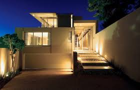 opulent house with lighting exterior and white outdoor accent wall