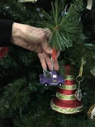 A Miniature Red Drum Set Emblazoned With The Initials WAM And Vintage Purple Louisiana State University LSU Truck Hauling Snow Covered Tree Were