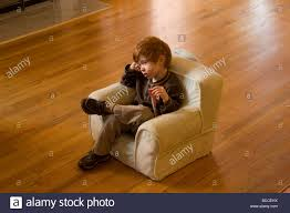 A 3-year-old Boy Watches TV In His Child-size Armchair Stock Photo ... Child Size Armchair White Leatherette Wood Frame Kids Chairs Seats Amazoncom Fniture Lifetime Stacking Chair Blue Brilliant Pintsized Thats High On Style Project Nursery Munityplaythingscom All Childs Sofas And Armchairs Camping Whosale Tables Ikea Center 34 Rare Sofa Pictures Design Kids Sofa Childrens Armchairs Our Pick Of The Best Ideal Home Upholstered Ding Comfy 25 Unique Chair Ideas Pinterest Room Fniture