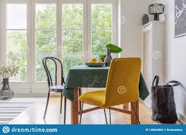 Vintage Dining Room Interior With A Table, Yellow Chair And ...