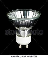 halogen light bulb on background with light rays stock photo