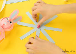 Take The Snowflake With Long Strips And Start Making A Paper Ball