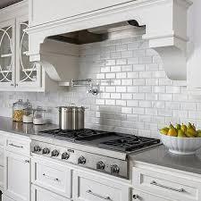 beveled marble subway tiles transitional kitchen casa verde