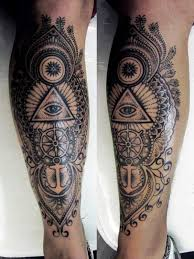 The Famous Single Eye Triangle Tattoo With A Steering Wheel Of Ship And An Anchor