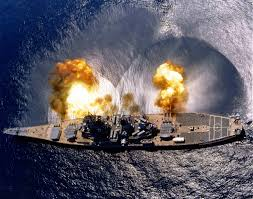 The USS Iowa Firing A Full Broadside Of Nine 16