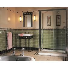 this deco style bathroom uses striking green metro style palm
