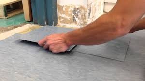 how to cut vct tile using a torch