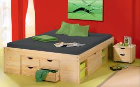Extraordinary Bedroom Decor Red Wall Paint Natural Wood Double Beds With Storage Dark Mattress Cover Green Pillow Case And Fitted Sheet Small Bedside Drawer