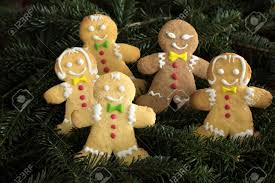 Group Of Funny Gingerbread Boys And Girls On Christmas Tree Stock Photo
