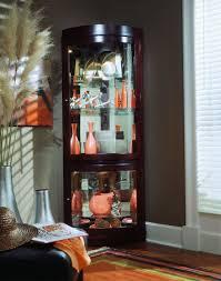 corner curio cabinet in chocolate cherry by pulaski home gallery