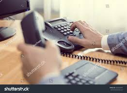 Businessman Dialing Voip Phone Office Keyboard Stock Photo ...