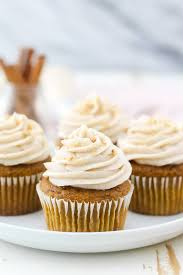A Head On View Of 4 Pumpkin Cupcakes White Rimmed Plate With Beautiful
