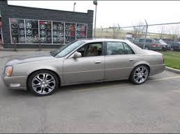 2000 CADILLAC DEVILLE RIDING ON 20 INCH CHROME RIMS &TIRES DONE