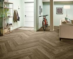 this is armstrong s charleston oak mocha in a herringbone laying
