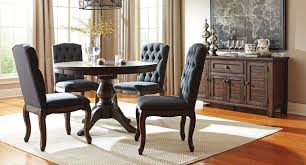Trudell Round Dining Set W/ Upholstered Chairs By Signature Design ... Trisha Yearwood Home Music City Hello Im Gone Ding Room Table Grey Griffin Cutback Upholstered Chair Along With Dark Wood Amazoncom Formal Luxurious 5pc Set Antique Silver Finish Tribeca Round And 2 Upholstered Side Chairs American Haddie Light Tone 4 Value Hooker Fniture Corsica Rectangle Pedestal Matisse With W Ladder Back By Paula Deen Vienna Merlot Kayla New