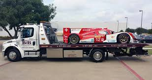 A Race Car Being Towed By Euless Wrecker
