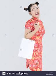 asian chinese with qipao dress hold shopping bag on