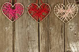 Valentines Day Yarn Hearts Forming A Top Border On Rustic Wood Background Stock Photo