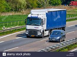 DUSSELDORF ,GERMANY - APRIL 20, 2017: Motorway With Big Cargo Truck ... Semi Truck Caucasian Driver Transportation Industry Heavy Duty Jw Sanders Truckingheavy Trailer Alignments New Lieto Finland April 12 2018 Orange Scania R650 B8x4 Gravel Pstruckphotoss Most Teresting Flickr Photos Picssr Trucking Home Auto Insurance Marketing Branding Kleidon Daf Xf95480 Superspacecab Neier Bz30jw A Austria The Truck Driver On The Road Among Fields Highway Business Trip Gondola Lift Arrive To Station Doors Open People Come Out How Get A Building In Named After You Stenger Peterbilt 379 Mid America Sho