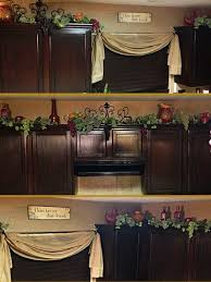 decor on top on kitchen cabinets grapes vines and porcelain