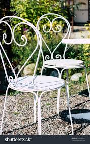 White Forged Furniture Garden Table Chairs Stock Photo (Edit ... Stunning White Metal Garden Table And Chairs Fniture Daisy Coffee Set Of 3 Isotop Outdoor Top Cement Comfort Design The 275 Round Alinum Set4 Black Rattan Foldable Leisure Chair Waterproof Cover Rectangular Shelter Cast Iron Table Chair 3d Model 26 Fbx 3ds Max Old Vintage Bistro Table2 Chairs W Armrests Outdoor Sjlland Dark Grey Frsnduvholmen China Patio Ding Dinner With Folding Camping Alinium Alloy Pnic Best Ideas Bathroom