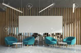 Office Waiting Area With A Wooden Wall Concrete Floor Loft Windows Blue