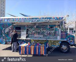 Photo Of Lunch Goer Getting His Food From A Food Truck