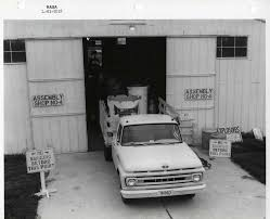 Photograph Of A Ford Truck With Rocket Parts In The Truck Bed Parked ...