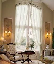 Bendable Curtain Rod For Oval Window by How To Holdbacks For An Arch Window Arched Window Treatments