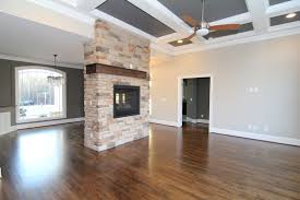 Two Sided Stone Fireplace Between The Formal Dining And Living Room