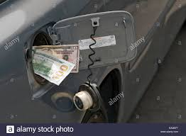 100 Gas In Diesel Truck Large Sum Of Cash In Diesel Truck Fuel Tank Fill Spout Stock Photo