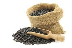 Dried Black Beans In A Burlap Bag Stock Photography